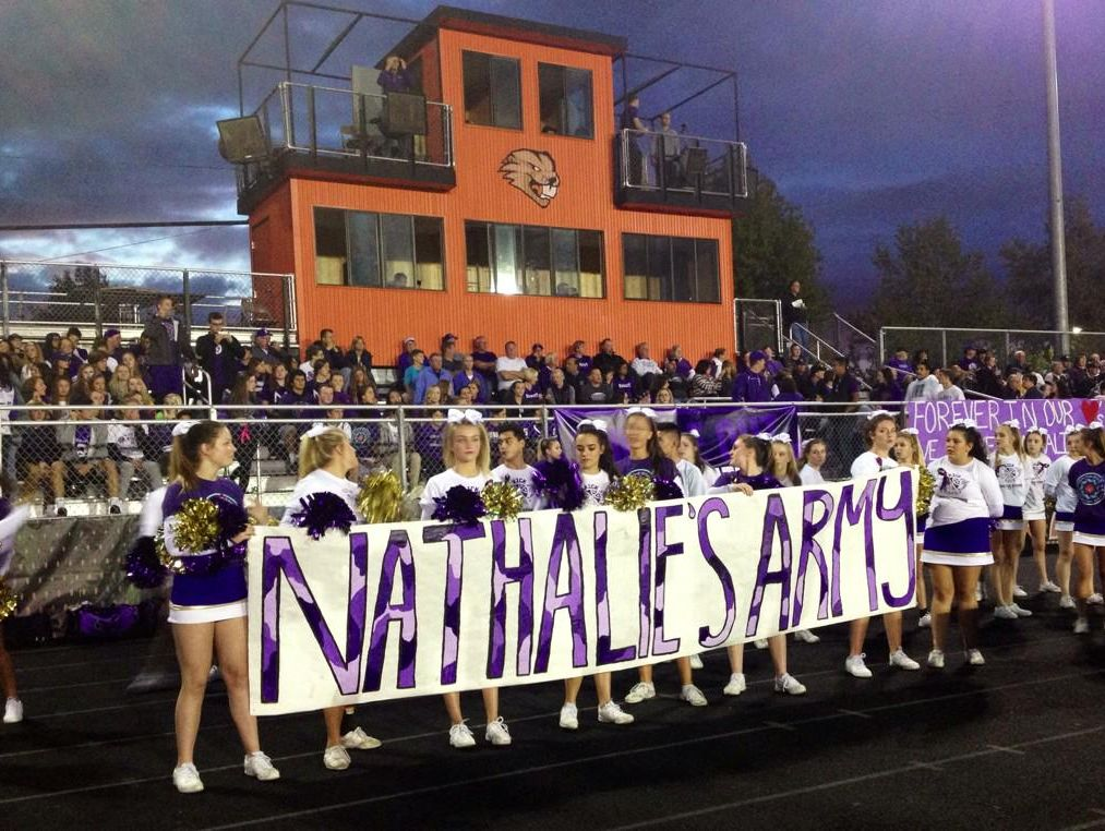 Sunset students honor Nathalie Traller Friday night.