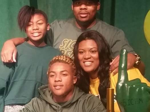 Maxwell Willis is joined by his family as he signs his letter of intent.