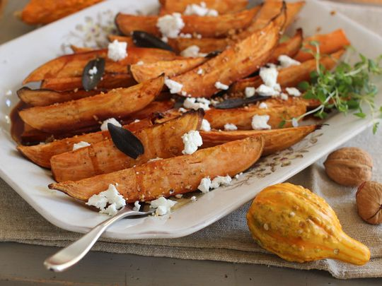 Cider-glazed sweet potatoes with fried sage, garlic and goat cheese ...