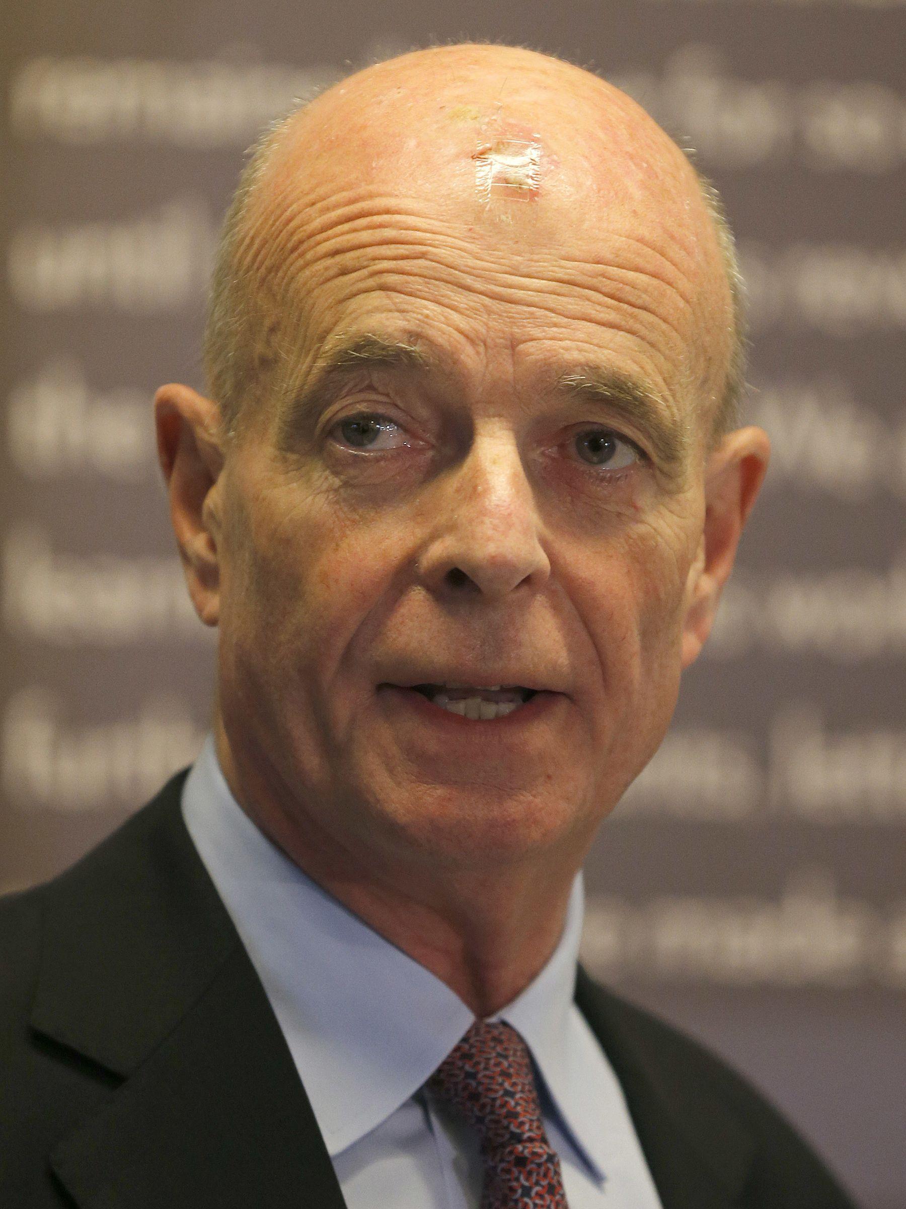 Former MI6 chief John Scarlett talks to the media as