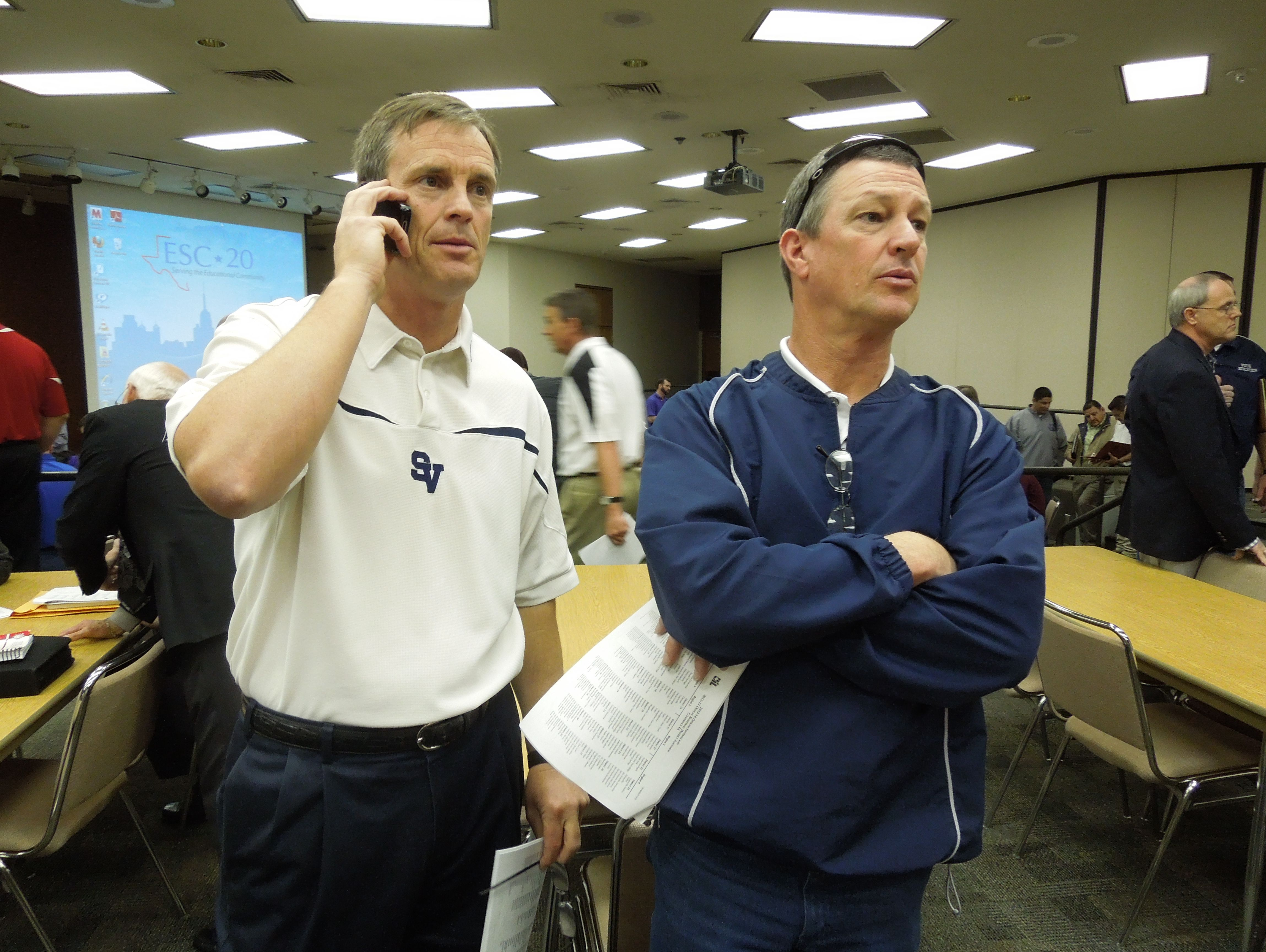 Larry Hill, left, with former Smithson Valley defensive coordinator Joe Moczygemba, is 229-63 in 23 seasons with the Rangers.