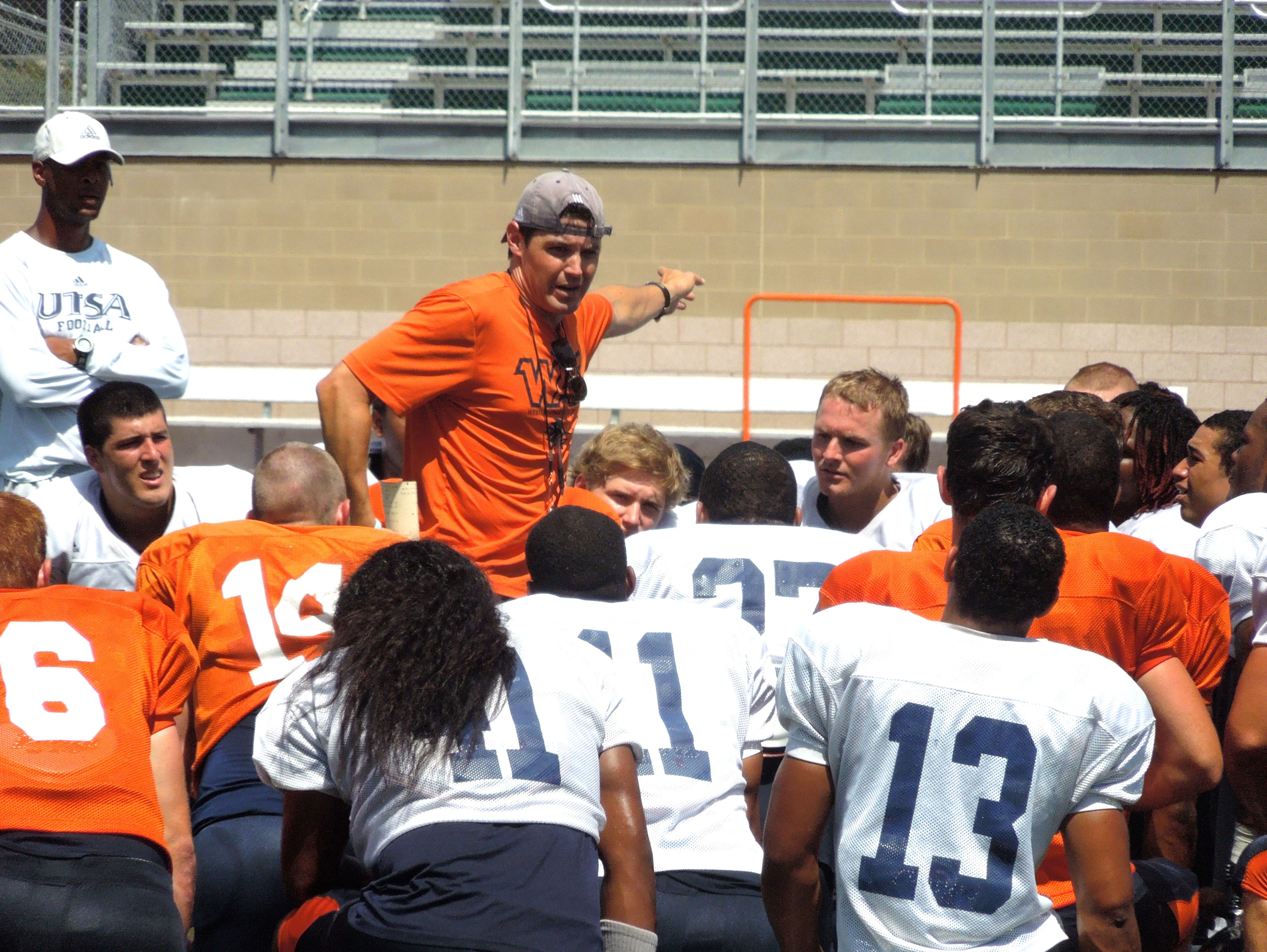 Kevin Brown, talking to UTSA players after a workout, was on Larry Coker's coaching staff for five seasons, the last four as offensive coordinator.