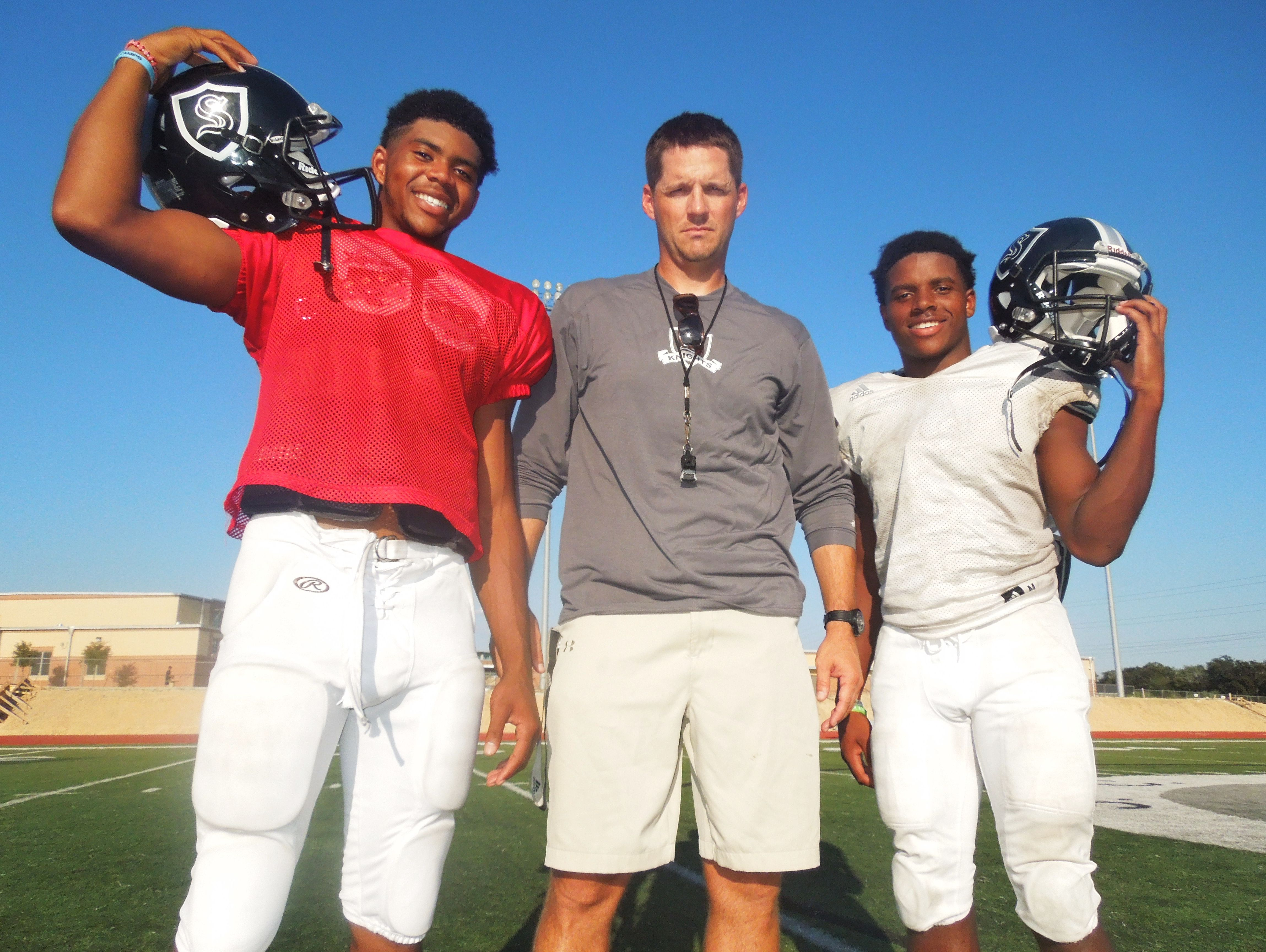 Steele coach Scott Lehnhoff, with quarterback Xavier Martin, left, and wide receiver C.J. Williams is 38-4 since taking over the Knights' program in 2013.