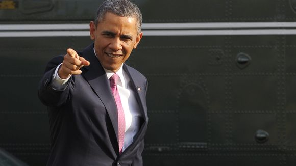 President Obama points to a person viewing his Marine