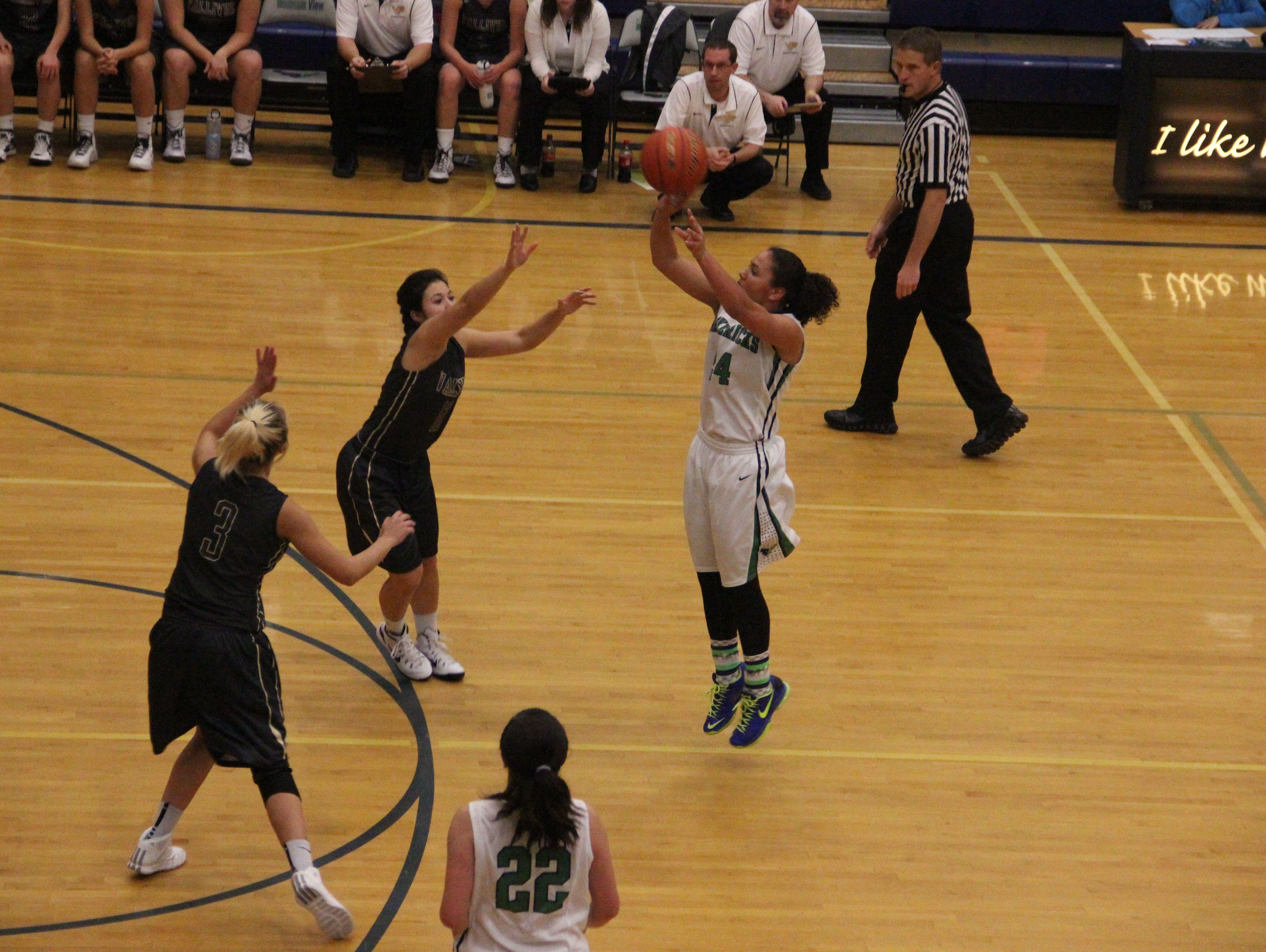 Destiny Slocum attempts a three-point shot against Vallivue.