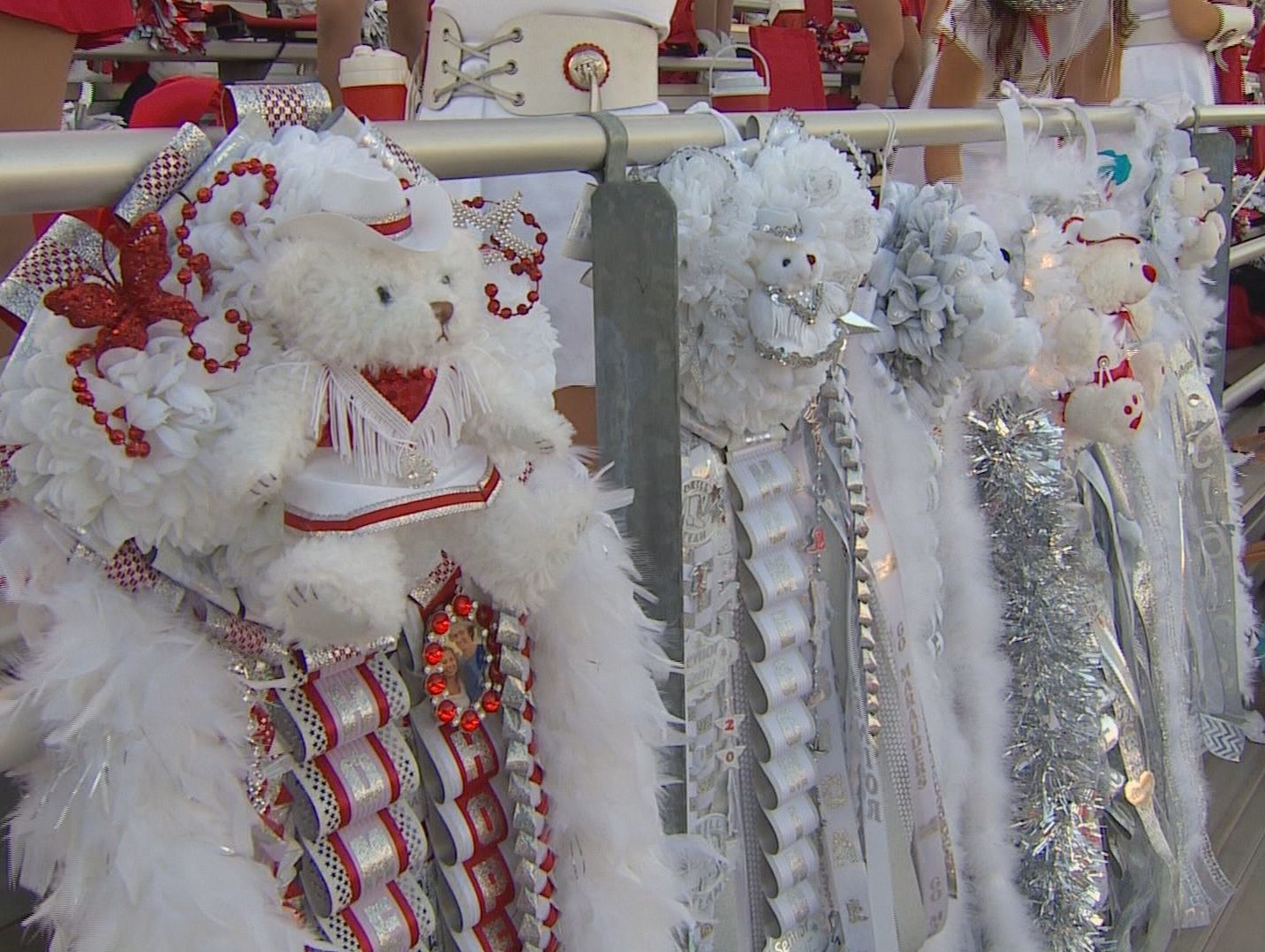 Mums hang on the fence at Flower Mound Marcus' football stadium