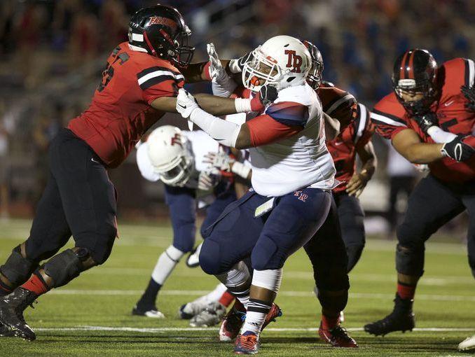 Stevens senior offensive tackle Trechun Oliver, left, blocks a Roosevelt lineman in the Falcons' 44-20 win last month.