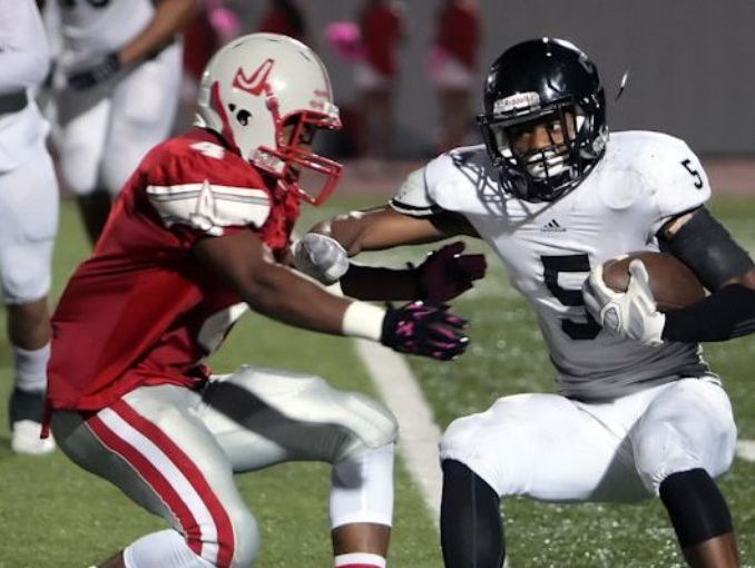Steele running back Bryson Denley comes face to face with Judson safety Delmarkus Dokes in last year's District 25-6A game at Judson's Rutledge Stadium.