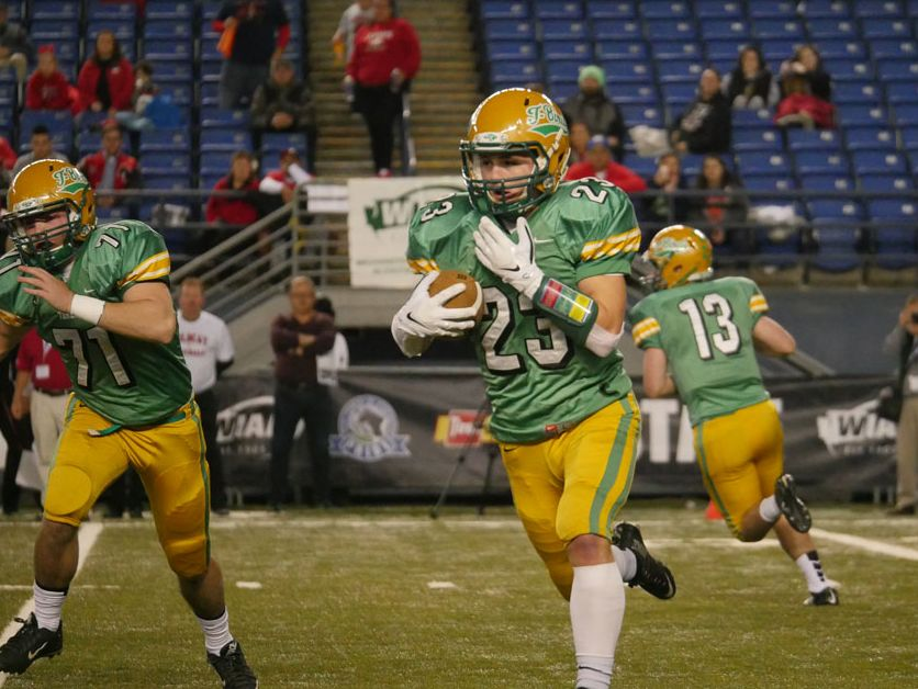 Tumwater's Noah Andrews takes a first quarter carry during the state semifinal game against Archbishop Murphy.