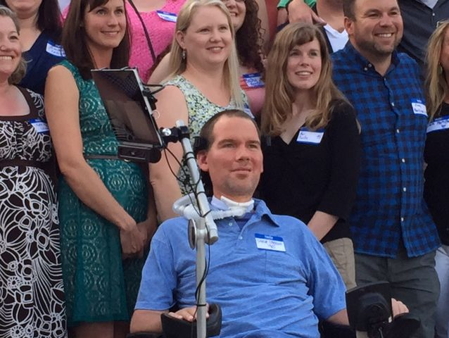 Steve Gleason poses for the Gonzaga Prep class of 1995 photo with his classmates.