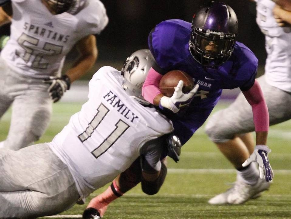 Hunter Donnelly (11), playing for Burleson Centennial, tackles James Guy of Crowley in a high school football game in October.