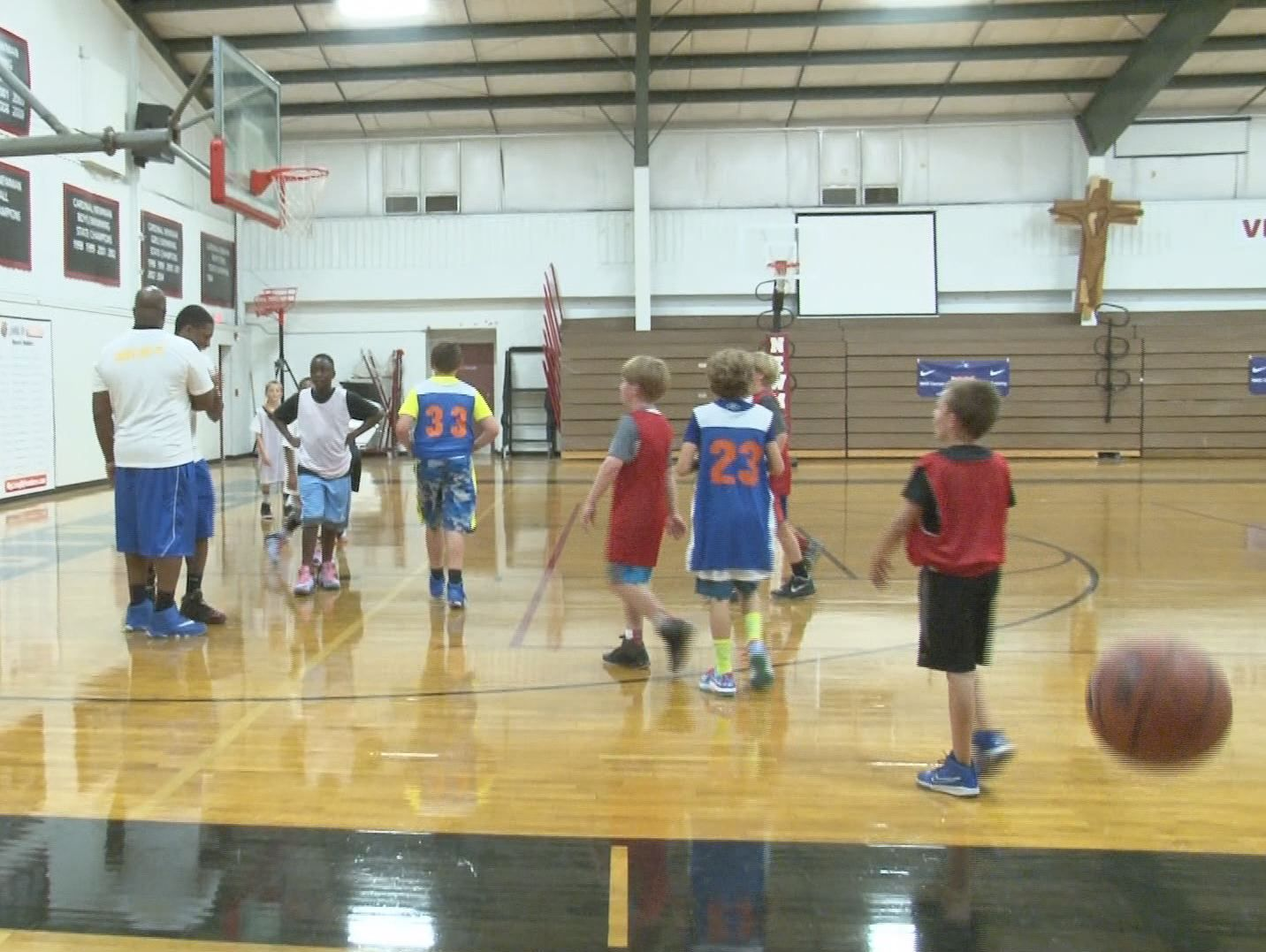 An enthusiastic group of 4th through 9th graders are at Cardinal Newman High School for a Nike basketball camp.