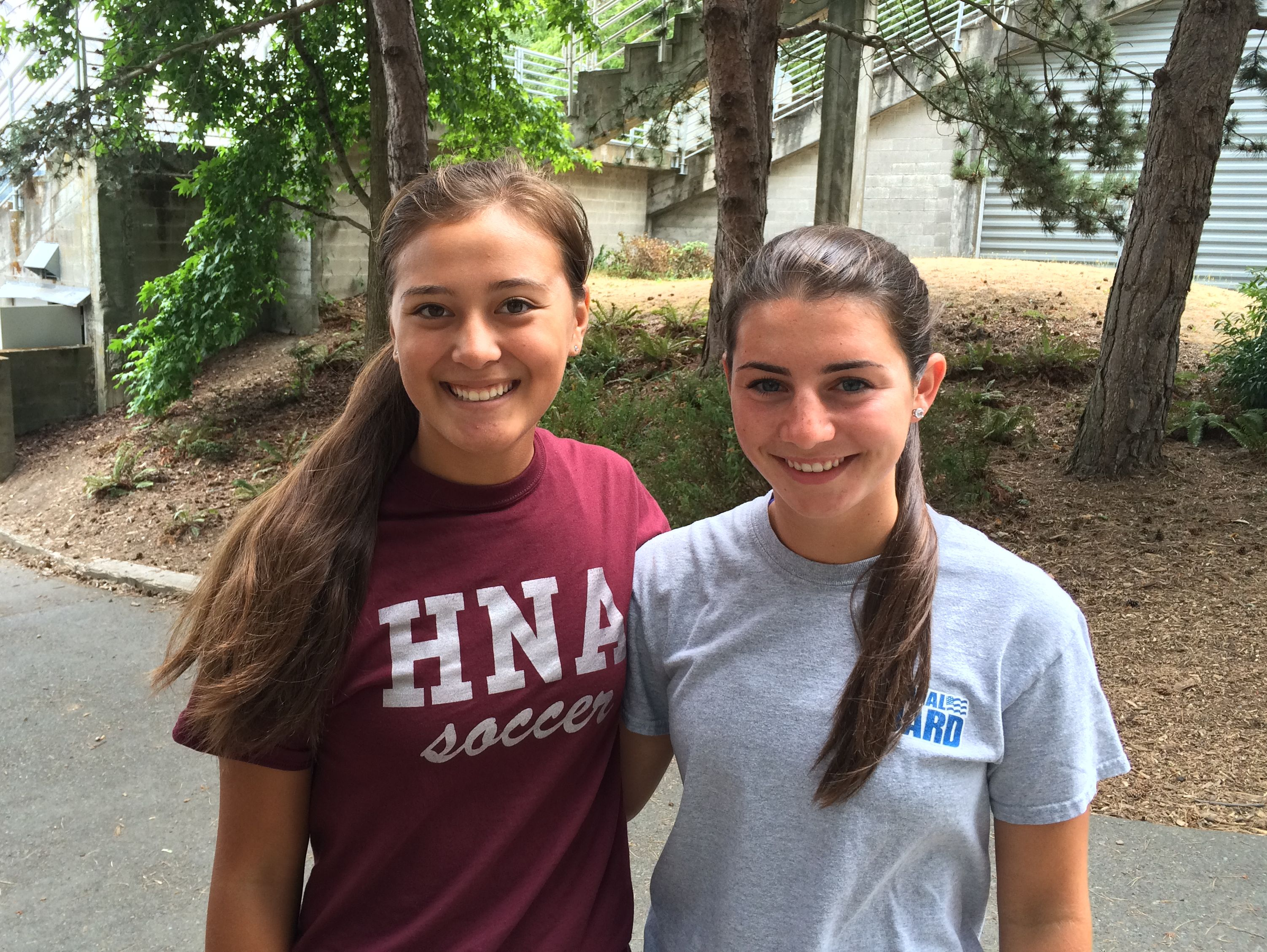 Holy Names girls soccer captains Claire Tevaseu (left) and Annie Flora at a team training run at Green Lake.