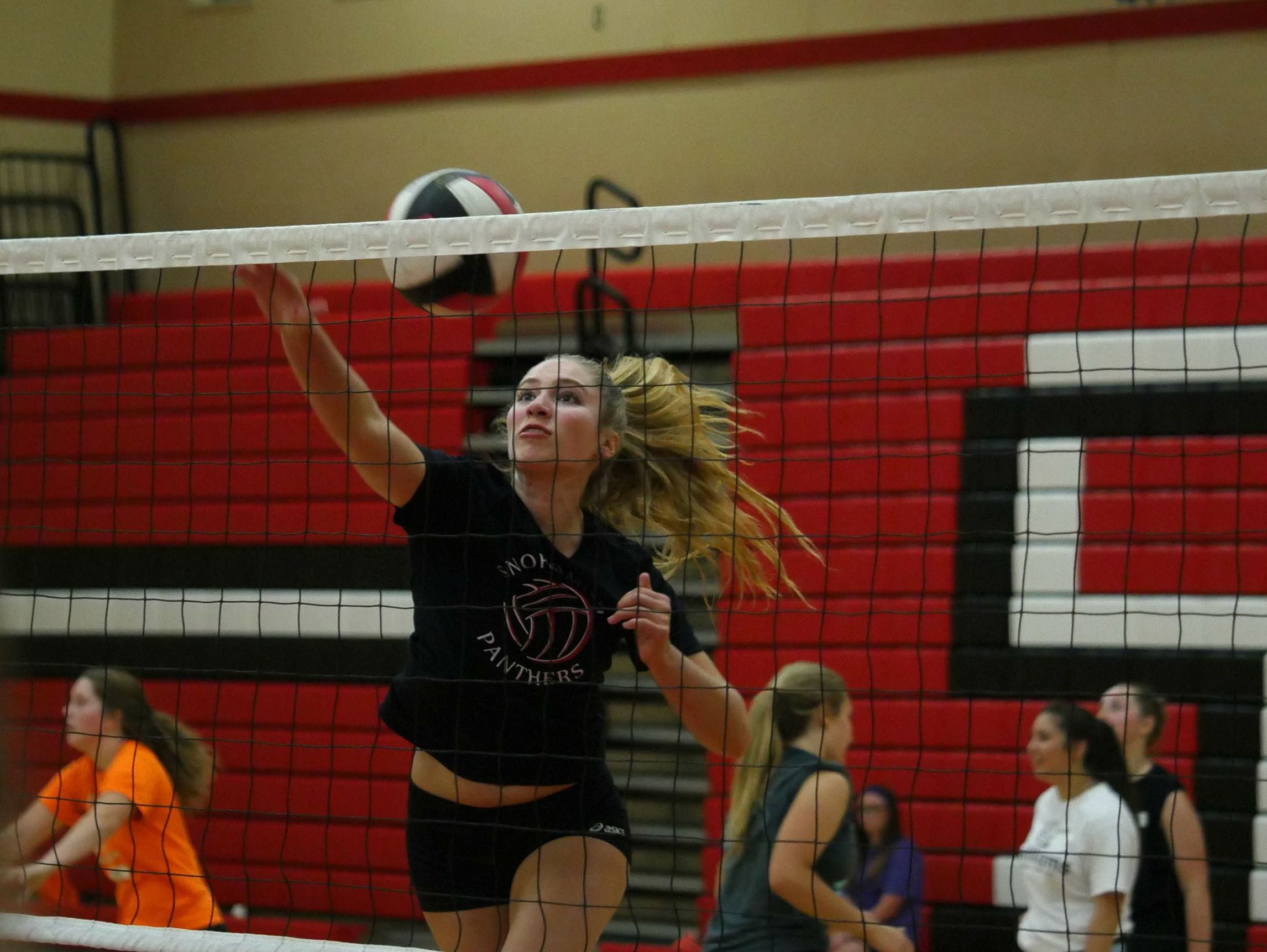 Snohomish libero Cyrene Hertzog at the net for a drill during the Panthers' first practice.