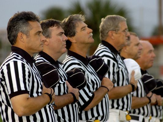 File photo - high school football officials.