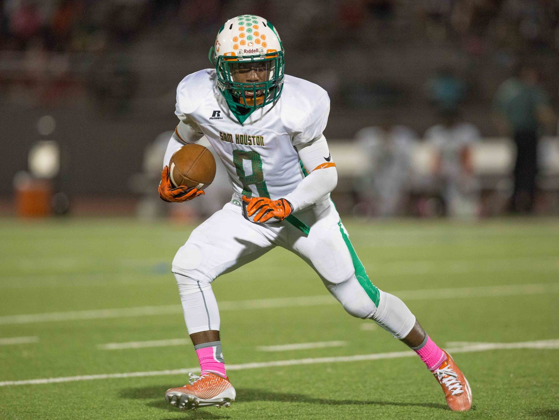 Senior wide receiver Travon Vaughns, running in the open field against Highlands, has caught 26 passes for 486 yards and six TDs this season.
