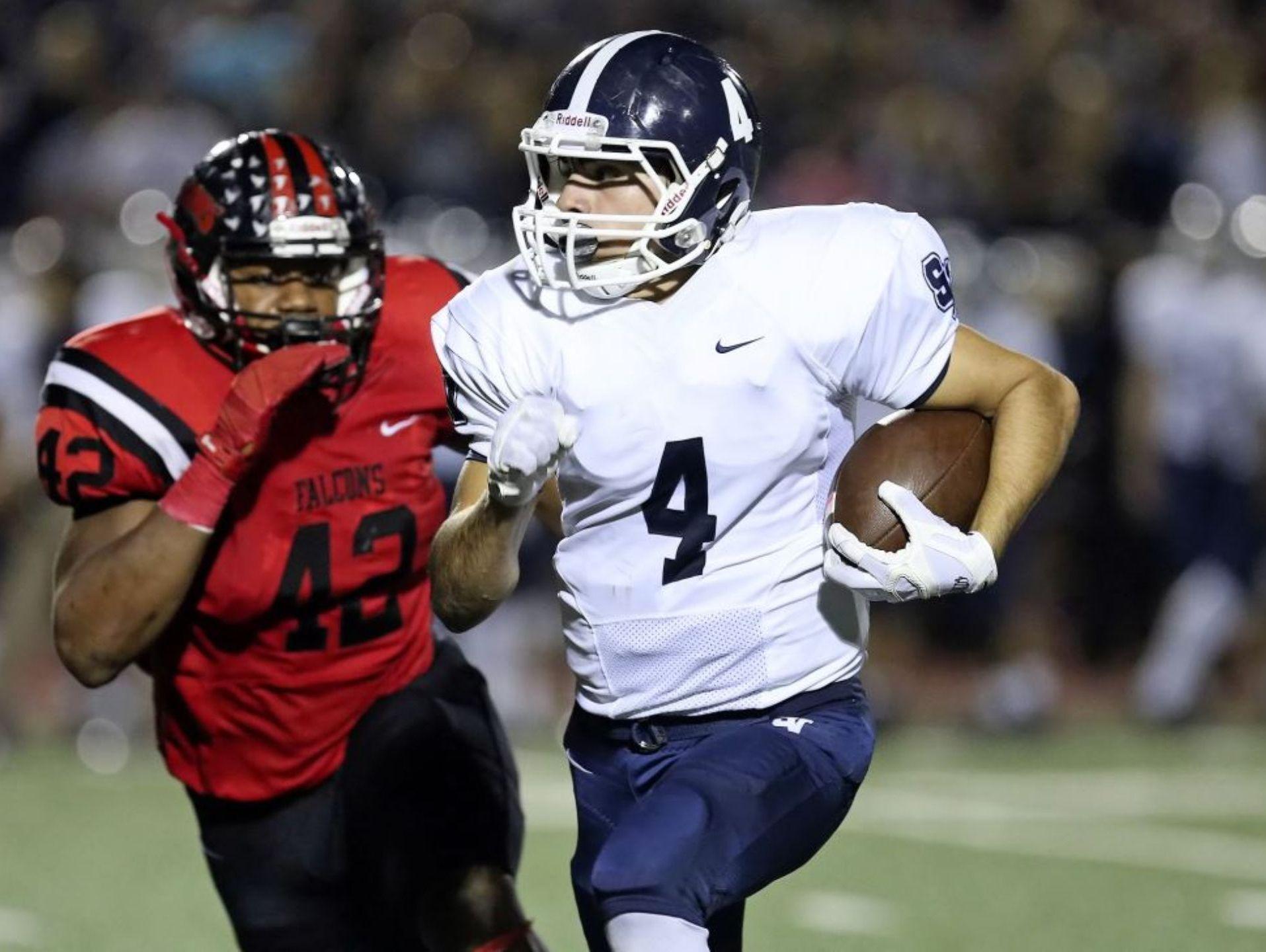Smithson Valley senior wide receiver Matt Sandoval, on the run against Stevens, caught two TD passes against the Falcons.