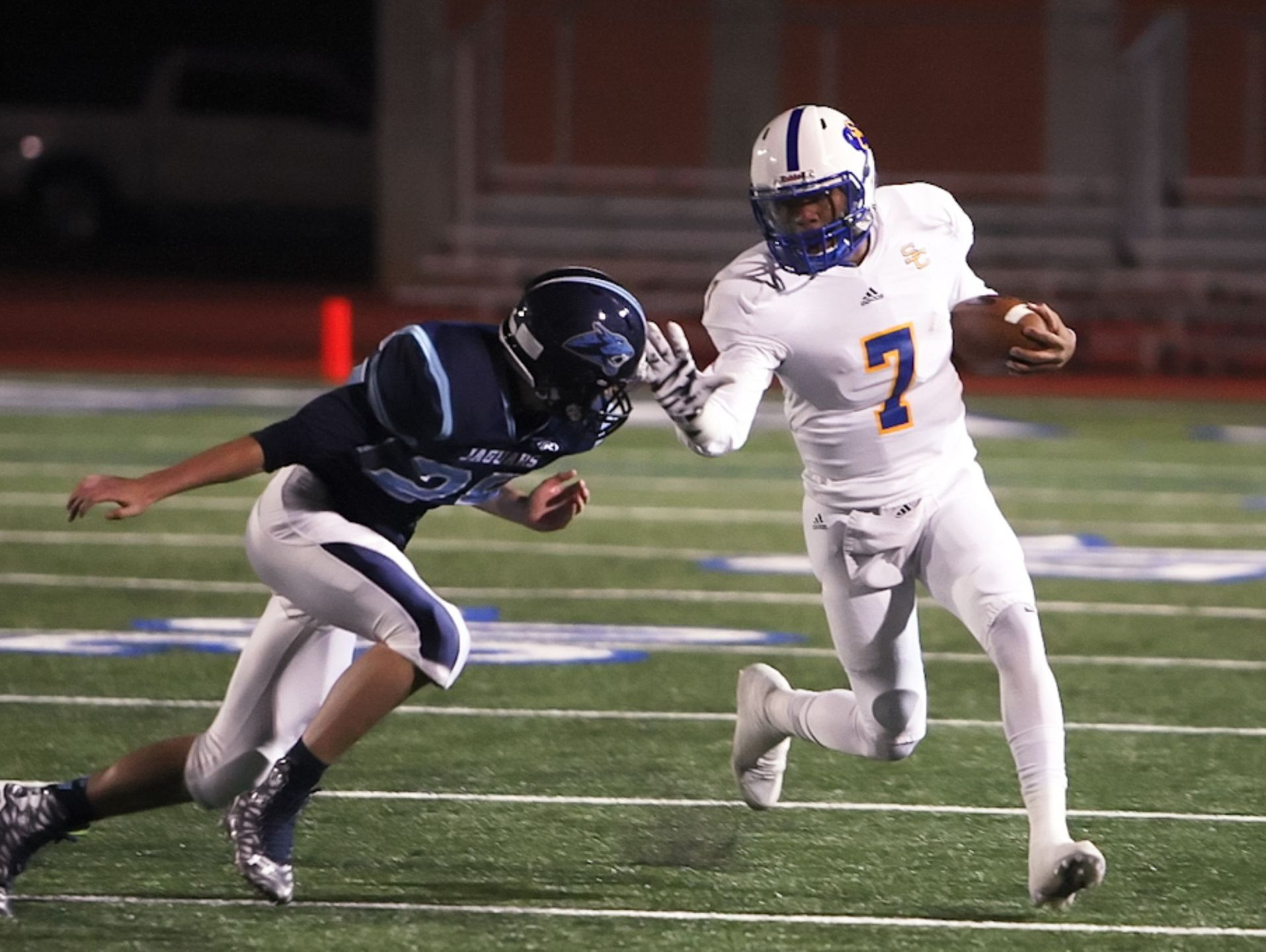 Clemens quarterback Frank Harris, on the run against Johnson in the playoffs, has amassed more than 4,500 yards of total offense and accounted for 53 TDs this season.