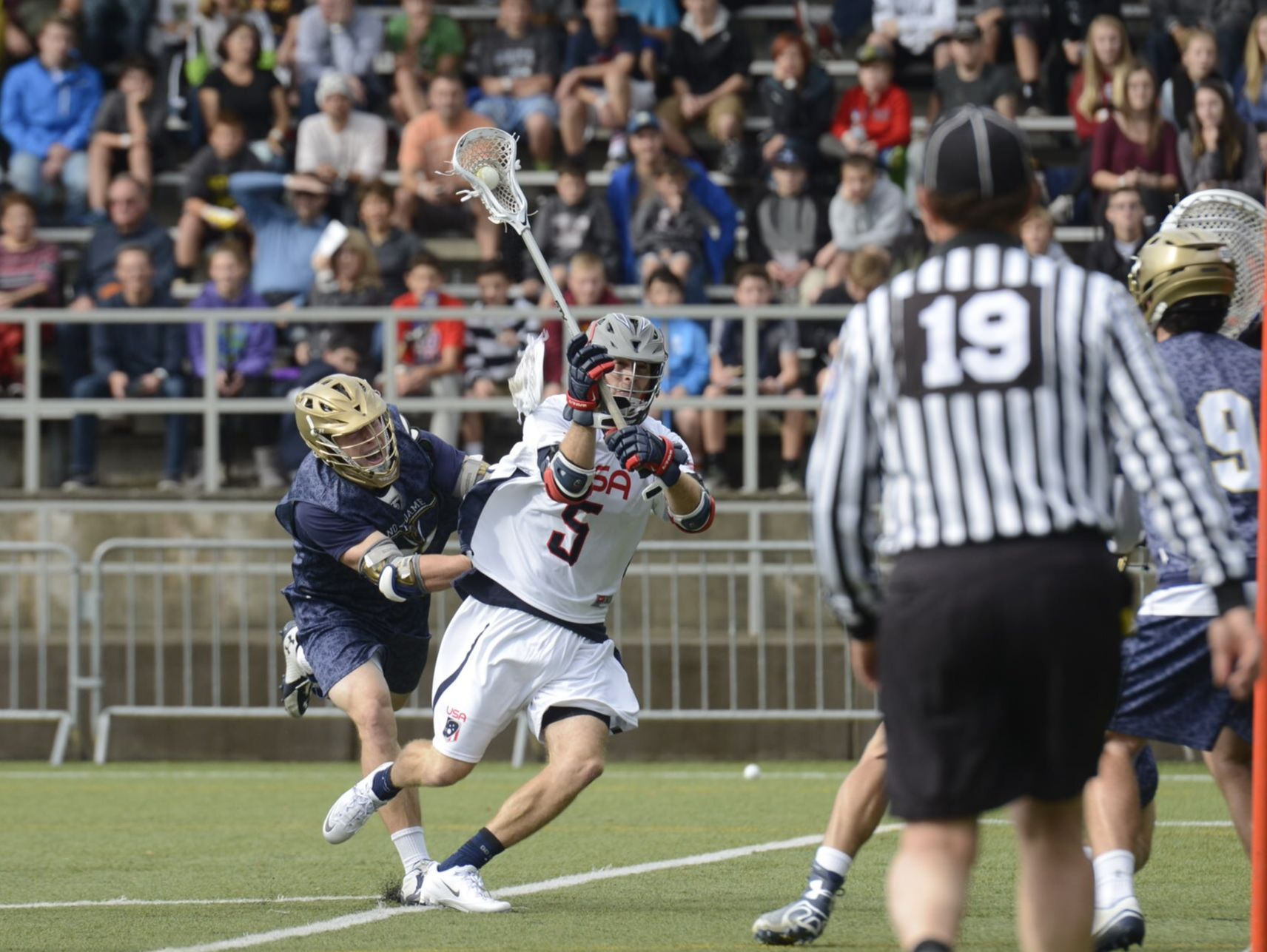 Seattle's Drew Snider (center), then playing for the U.S. National Team, takes a shot on the Notre Dame goal during the 2014 Seatown Classic at the Starfire Sports Complex in Tukwila.