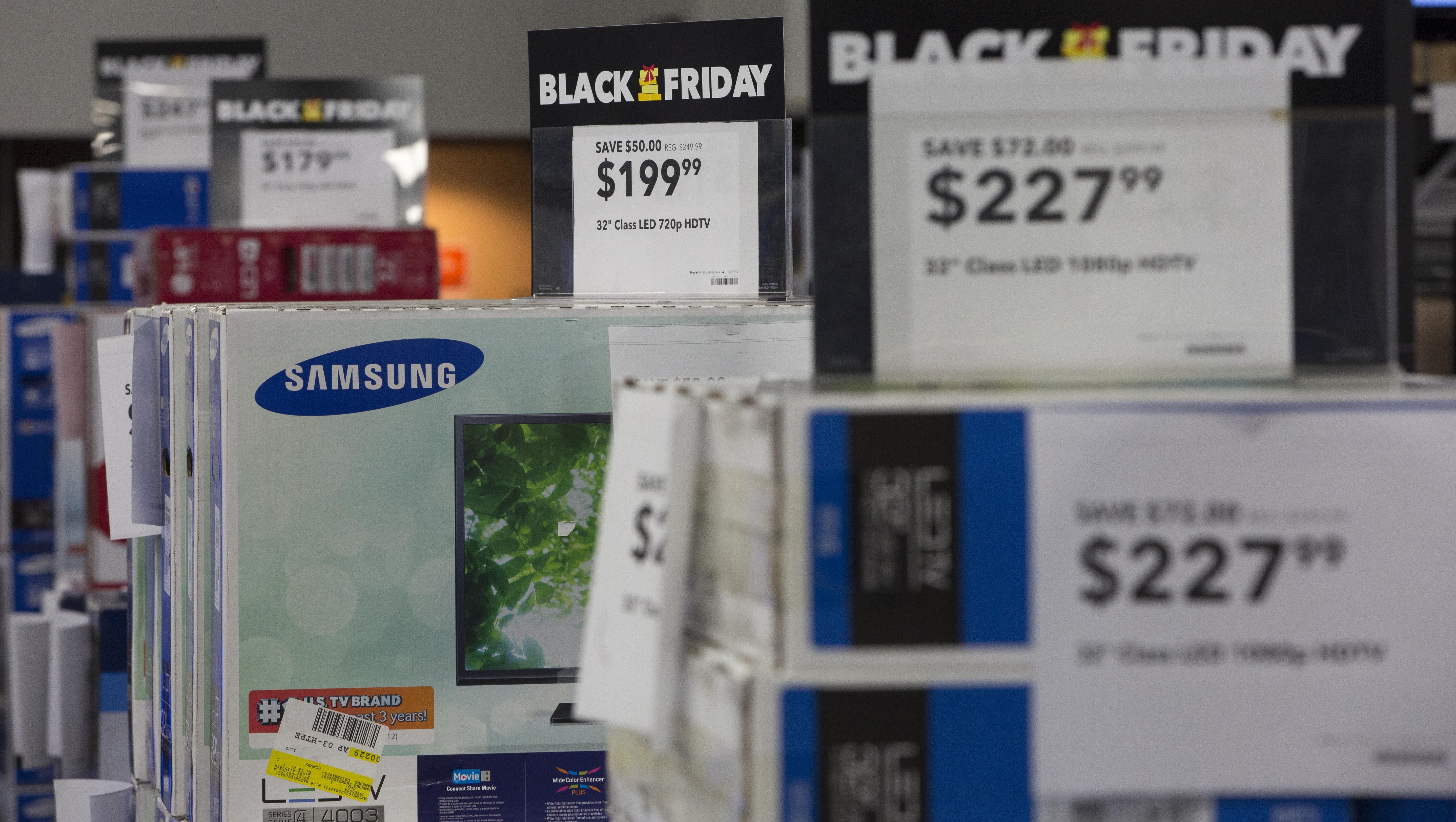 Televisions are seen on sale Thanksgiving evening at a Best Buy.