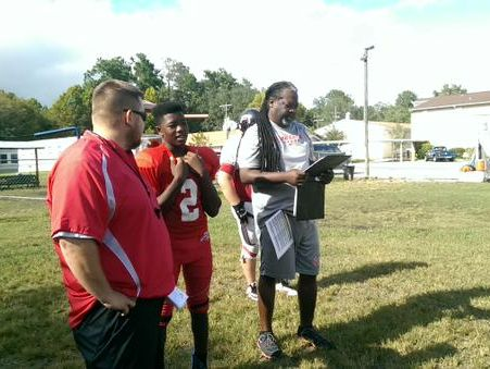 Ivory Durham IV chats with two of his coaches from Cedar Creek Christian School.