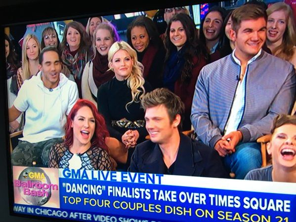 The Ware County cheerleaders in the background on the set of Good Morning America.