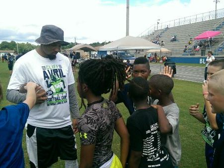 Nolan Carroll talks with some participants in Cliff Avril's free football camp at Clay High School on Saturday, June 27, 2015.