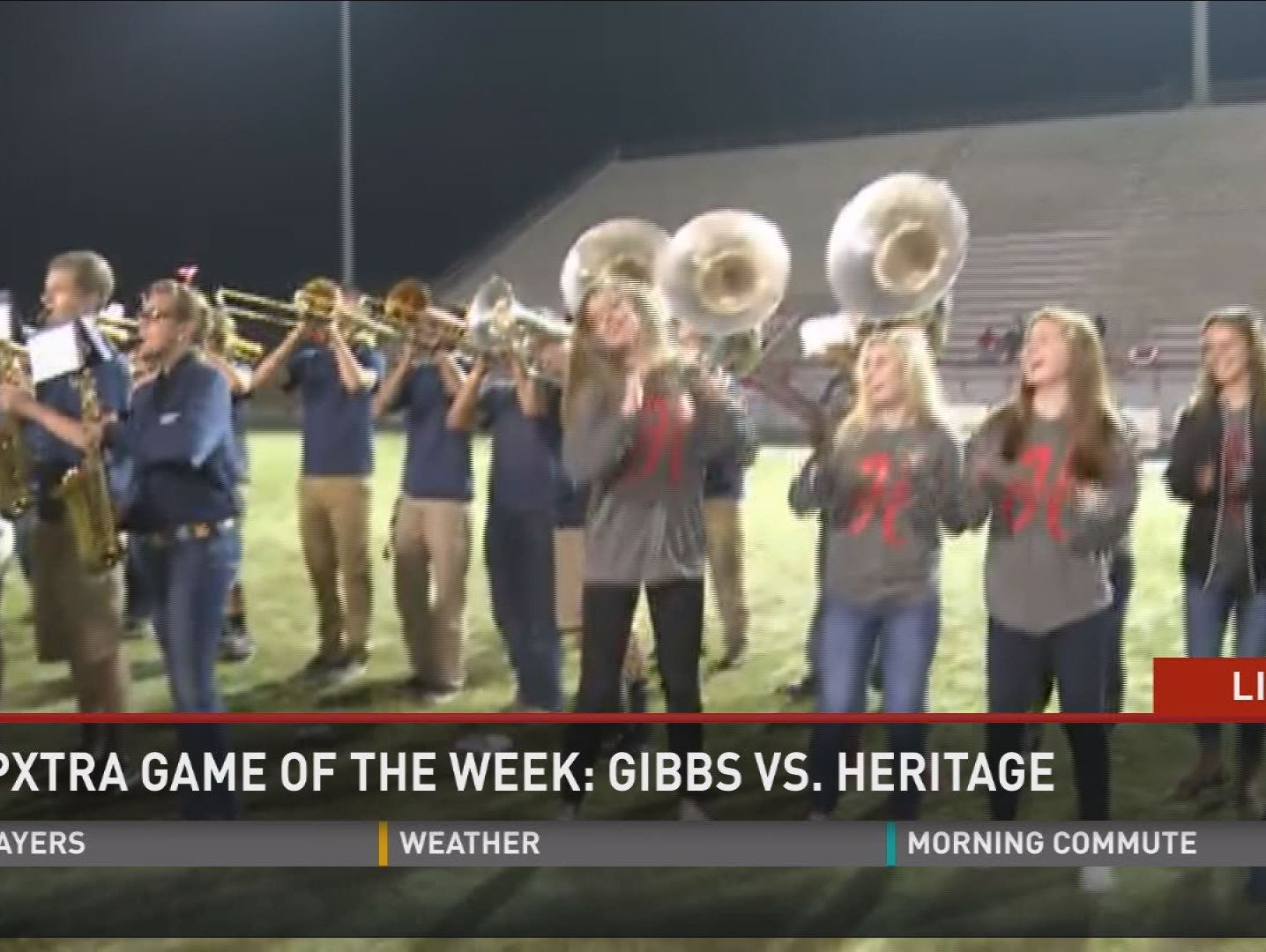 The Heritage High School band, cheerleaders, and dance team perform during the PrepXtra Game of the Week pep rally