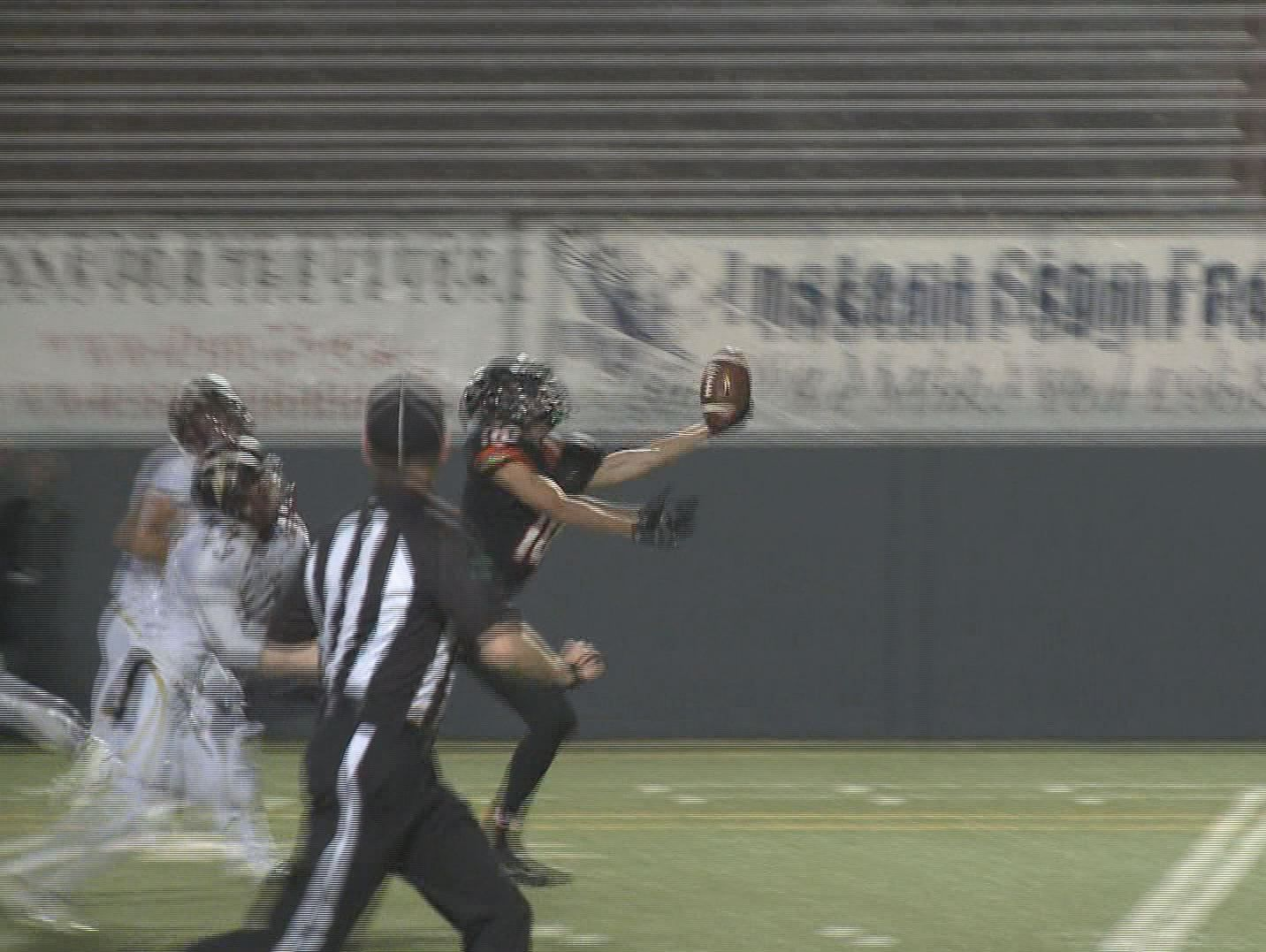 Leo Haghighi of Lewis and Clark makes an incredible one-handed catch at Joe Albi Stadium against University. The Tigers beat the Titans 24-21.